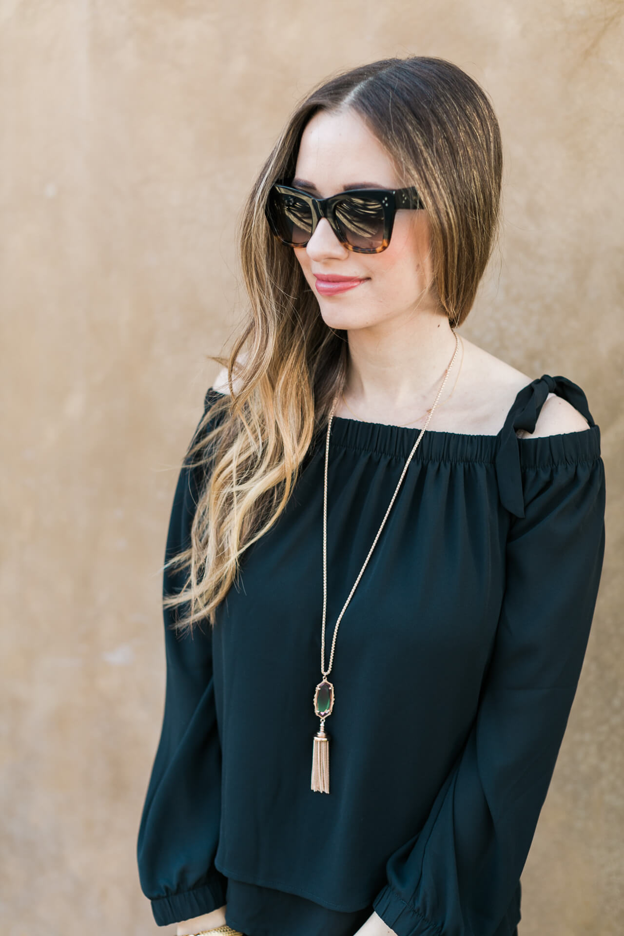 black off the shoulder top styled for winter