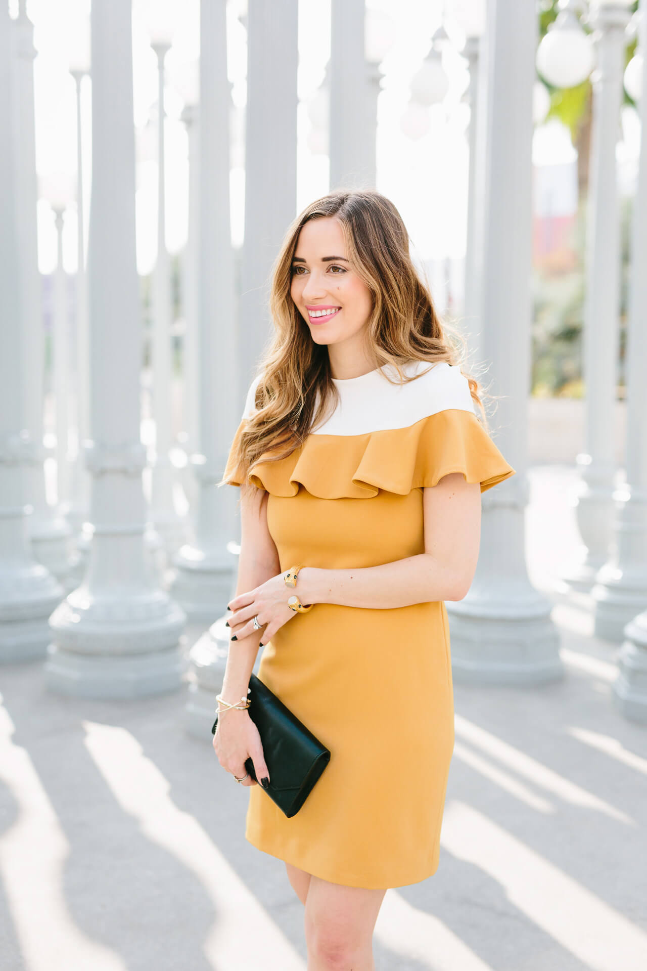 feminine outfit inspiration with a mustard dress