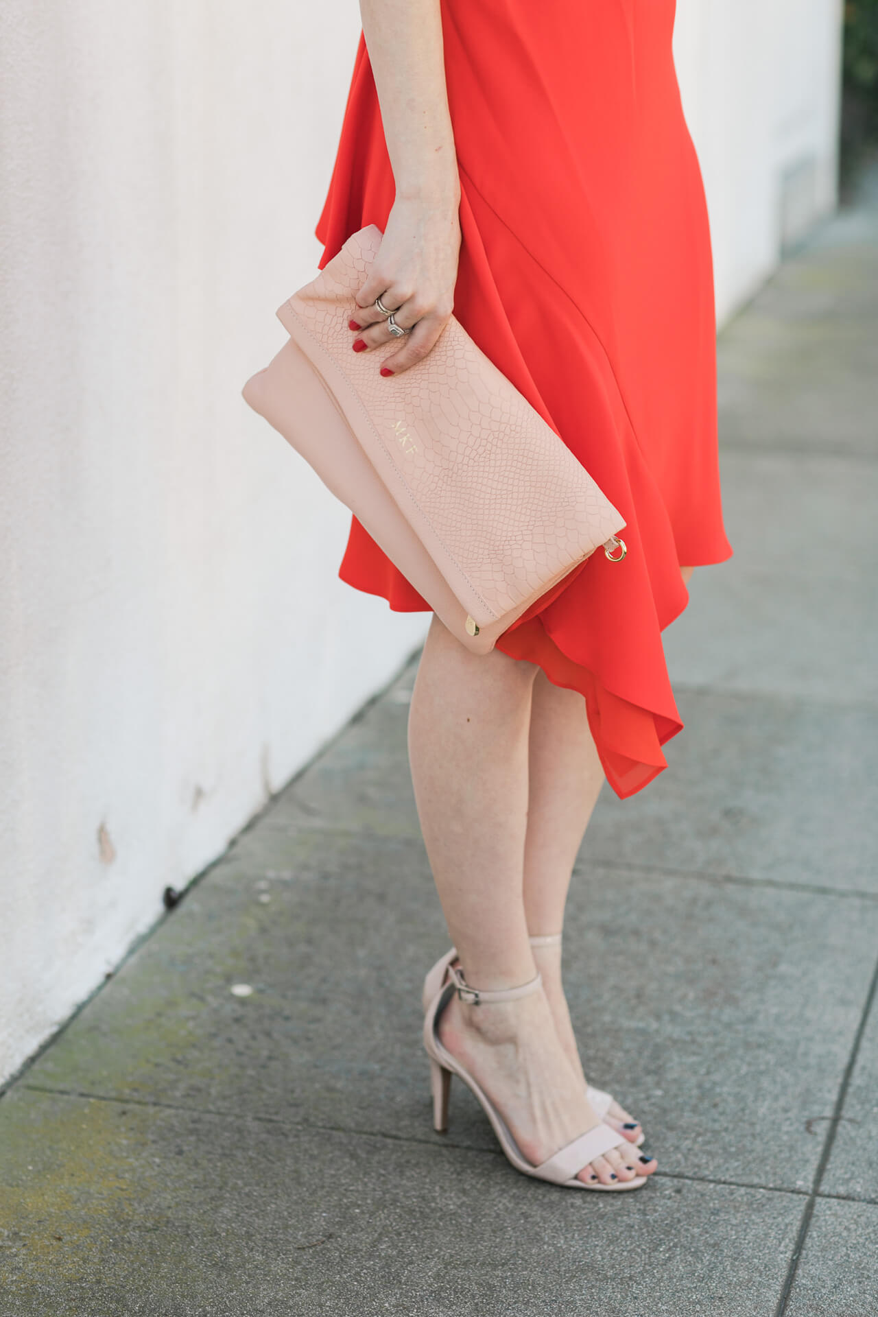 gigi new york clutch with red ruffled dress