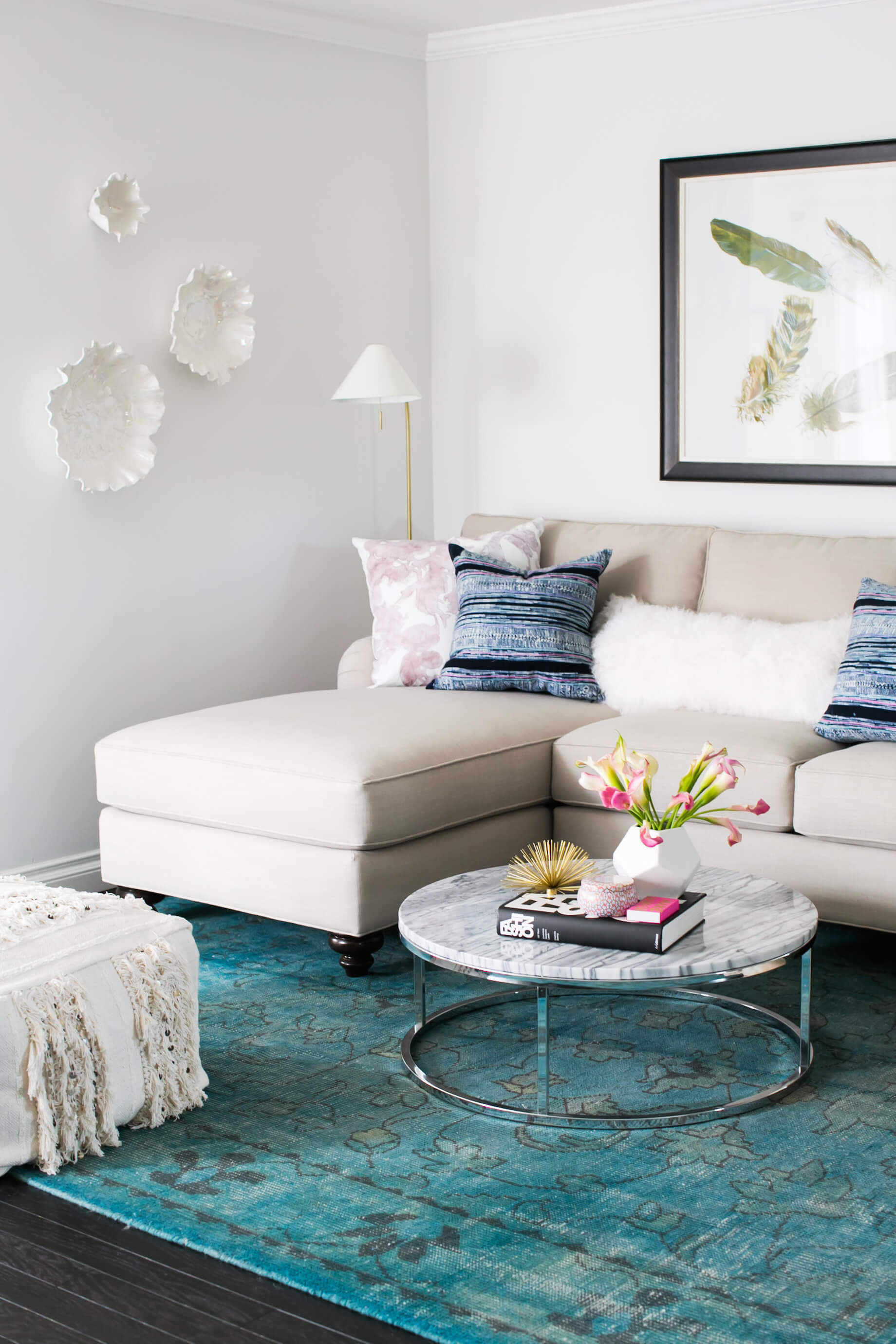 blue and beige living room with moroccan wedding blanket poufs)