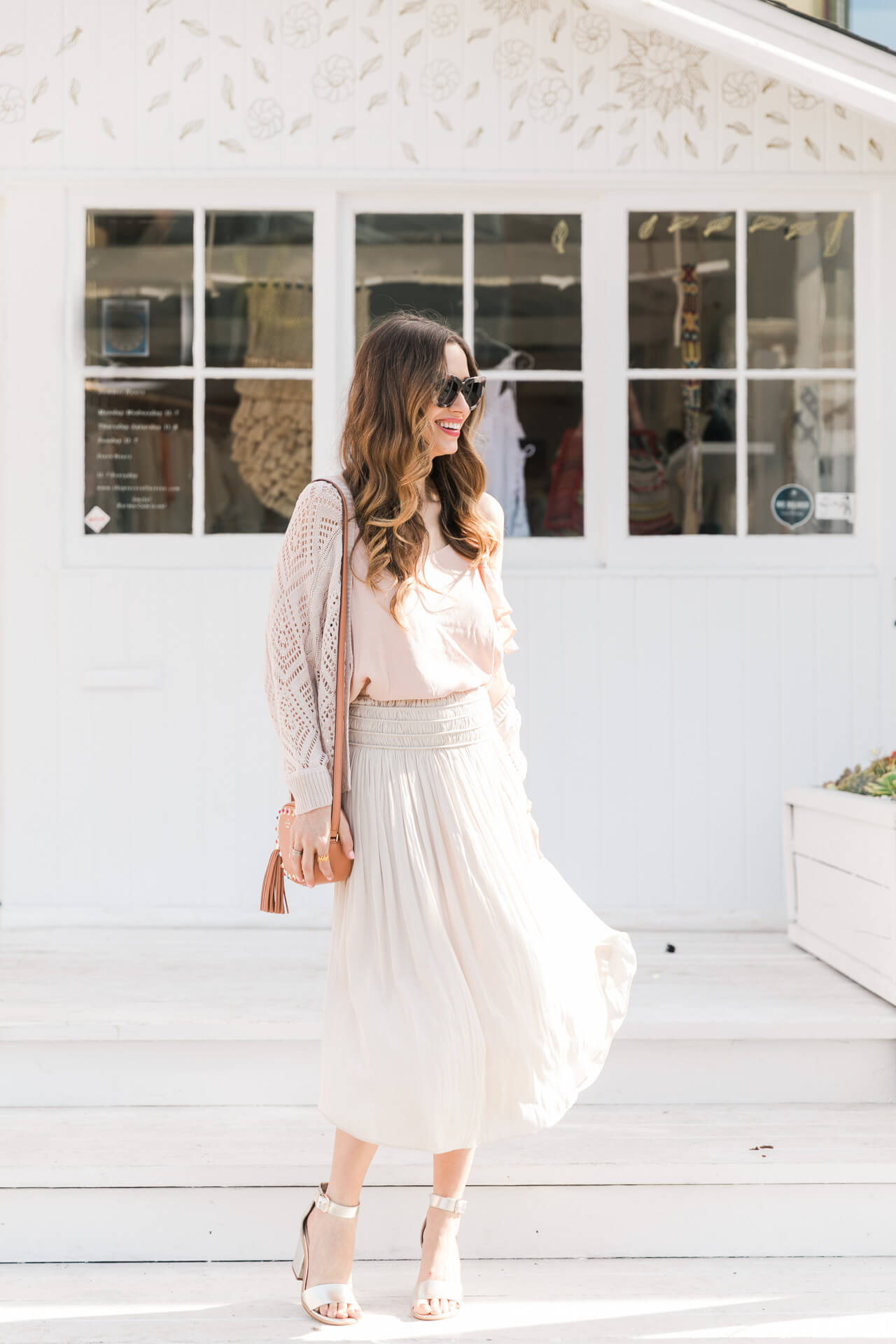 pink blouse with cream flowy skirt