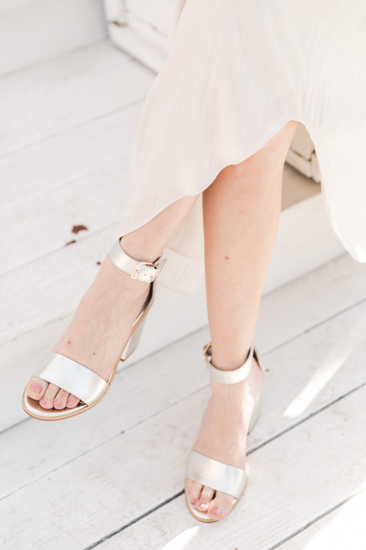 beige skirt with silver sandal heels