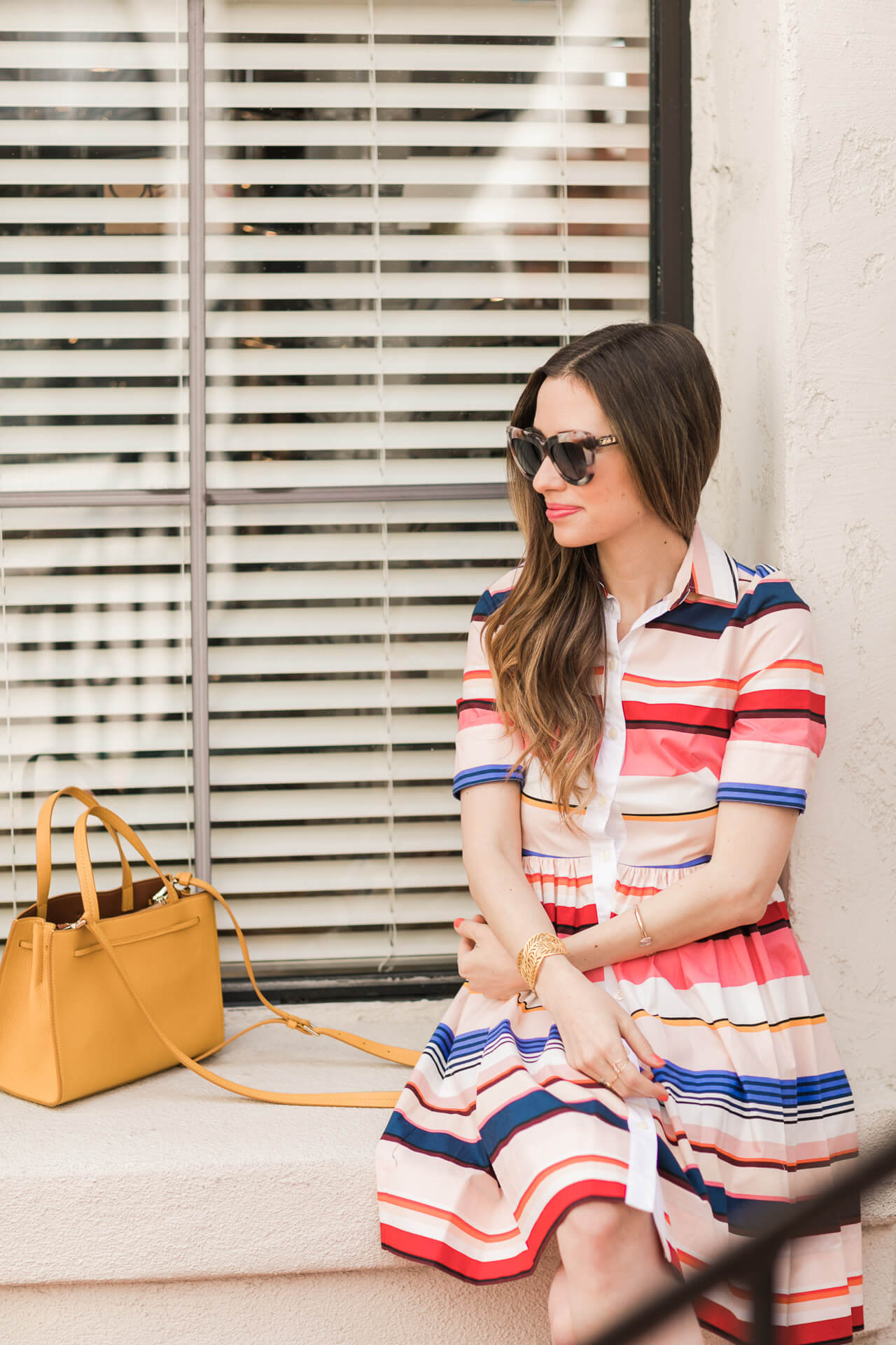 feminine outfit inspiration with kate spade striped dress