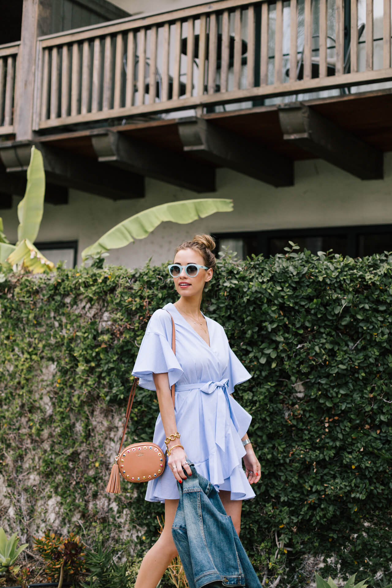 summer outfit inspiration with blue poplin striped wrap dress and denim jacket