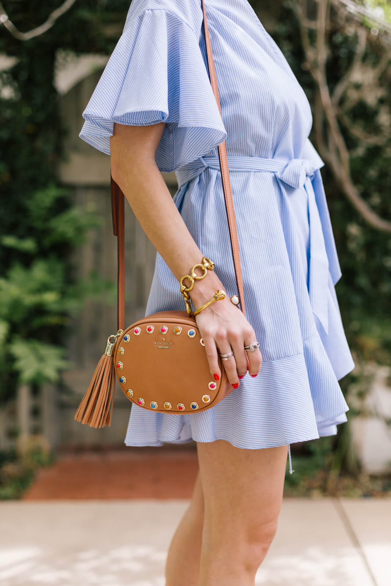 this kate spade camera bag is so cute! Love the tassel and stone detail (also comes in mustard!)