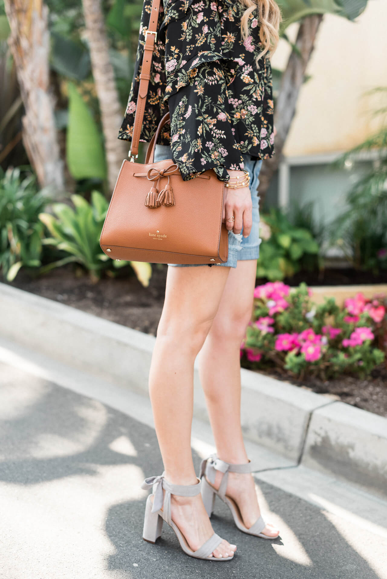 gray suede heels with denim shorts and kate spade bag
