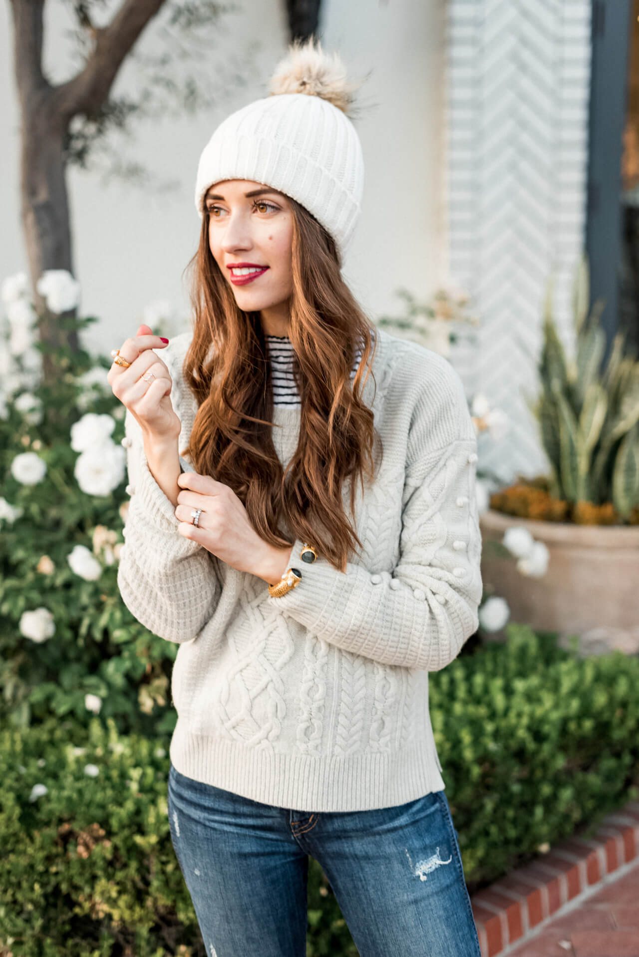 Styling this pom beanie with a sweater and knee-high boots on M Loves M