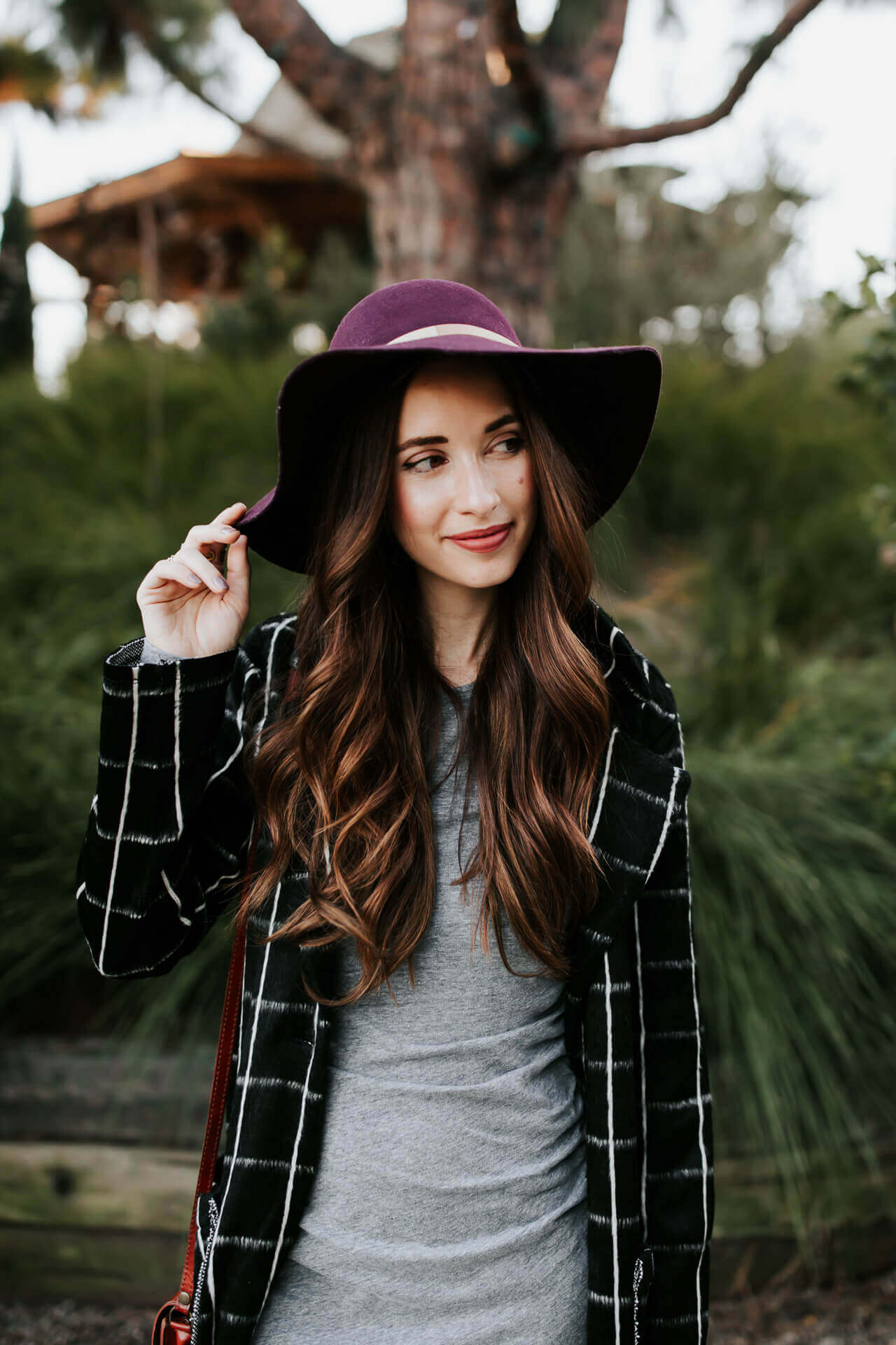a pretty burgundy hat is the perfect accessory with a neutral colored outfit