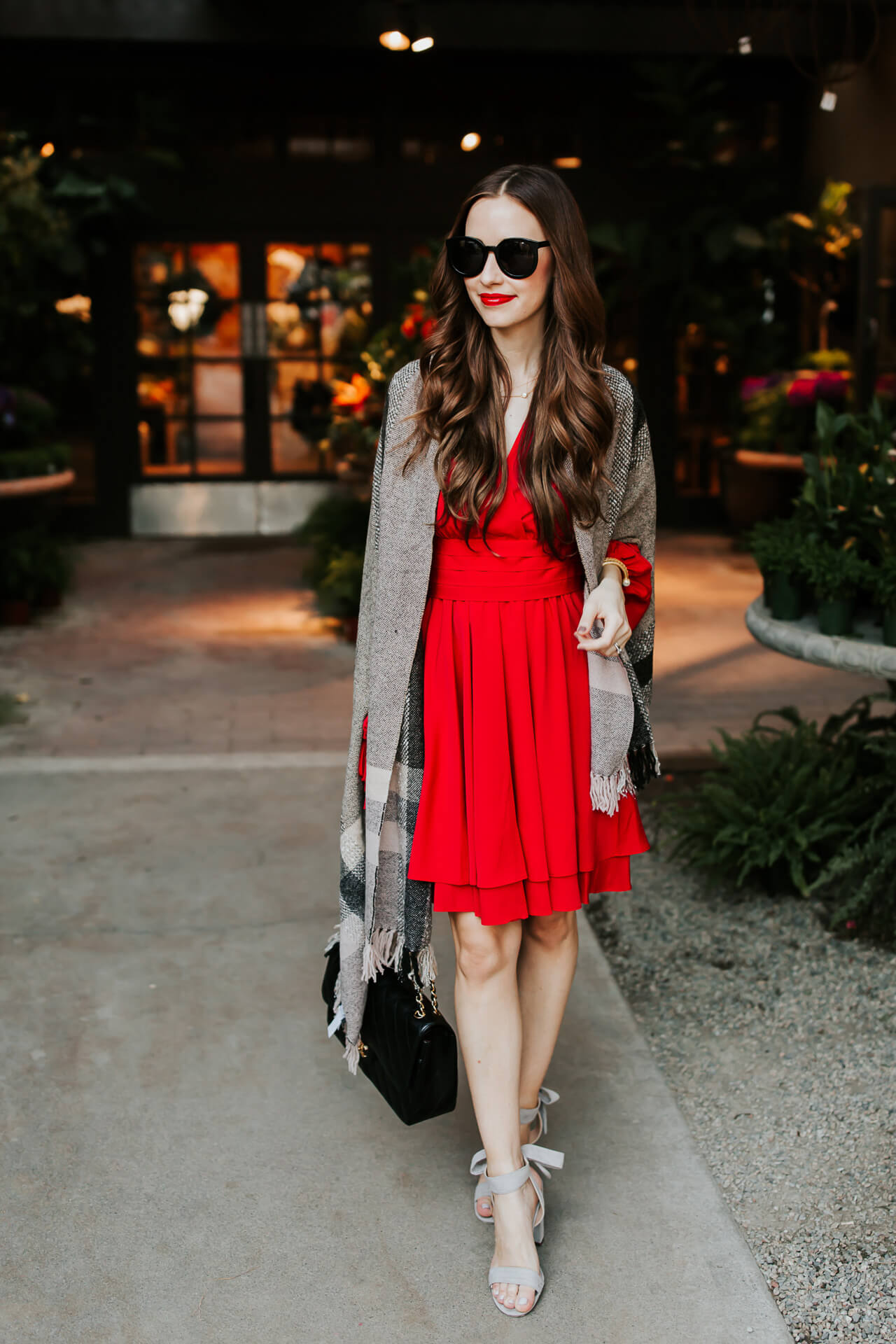 paired a neutral plaid poncho over this little red dress - M Loves M @marmar