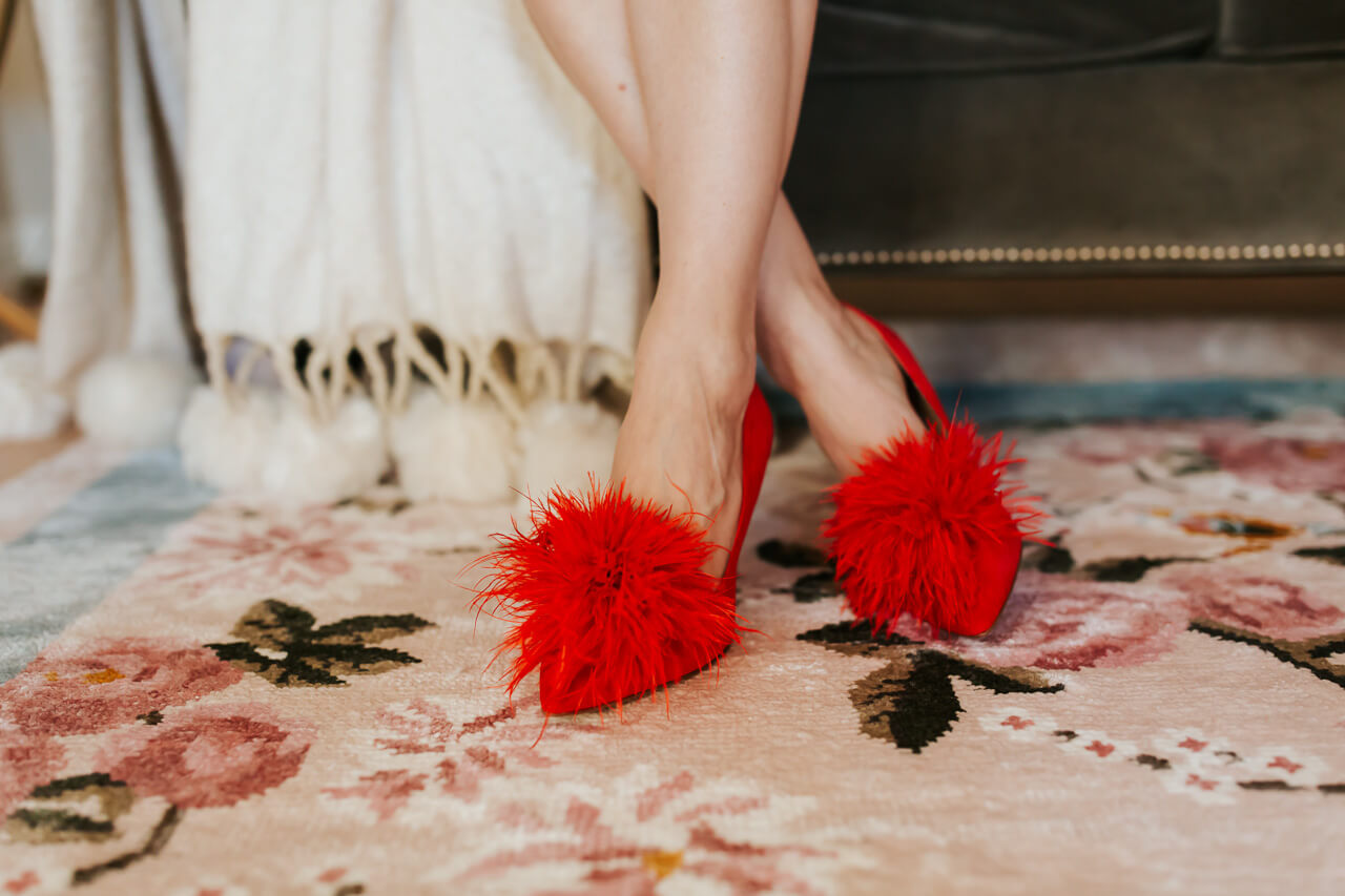 the prettiest pom heels with a floral rug from the Gal Meets Glam x Lulu and Georgia collaboration