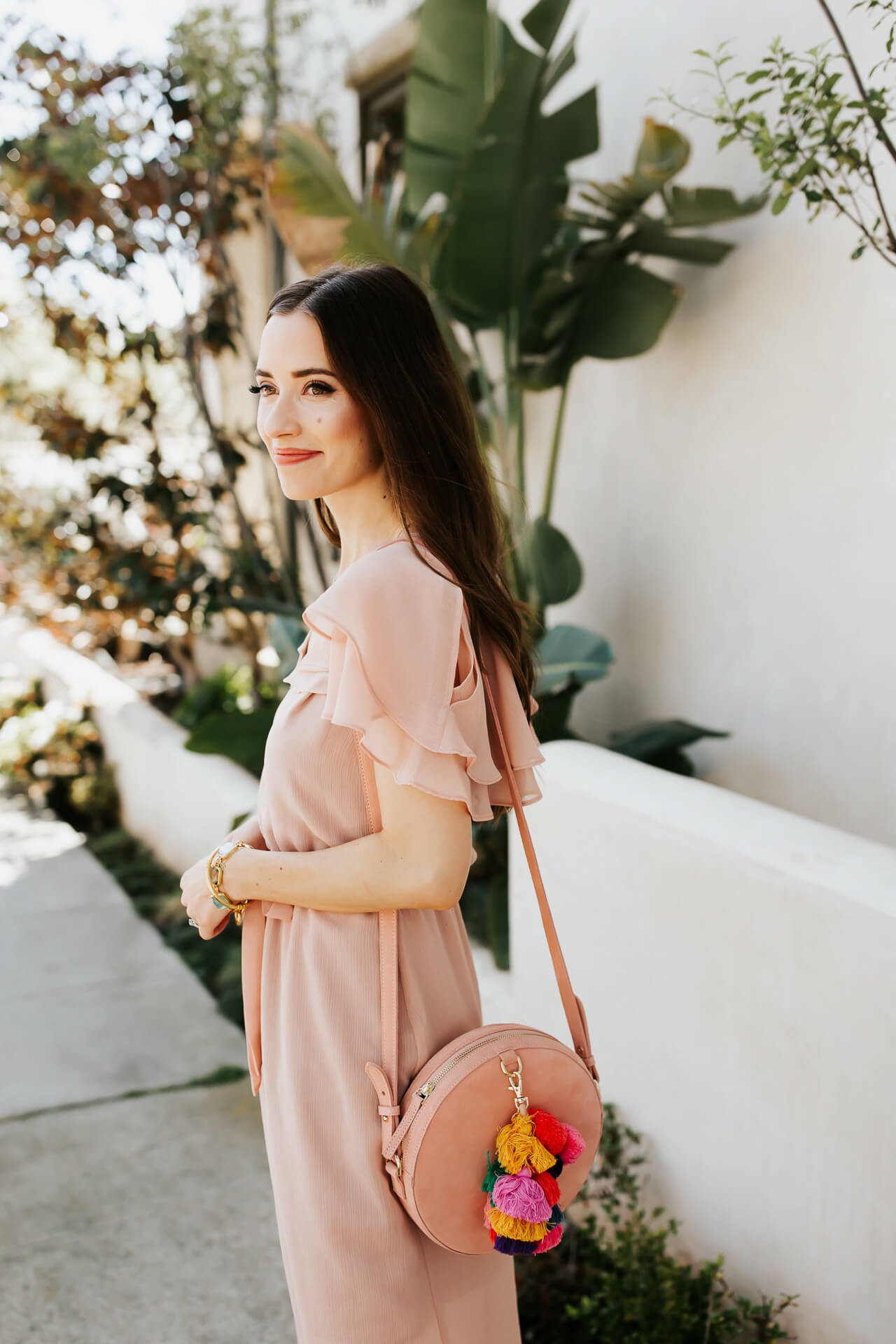 blush pink maxi dress with suede bag