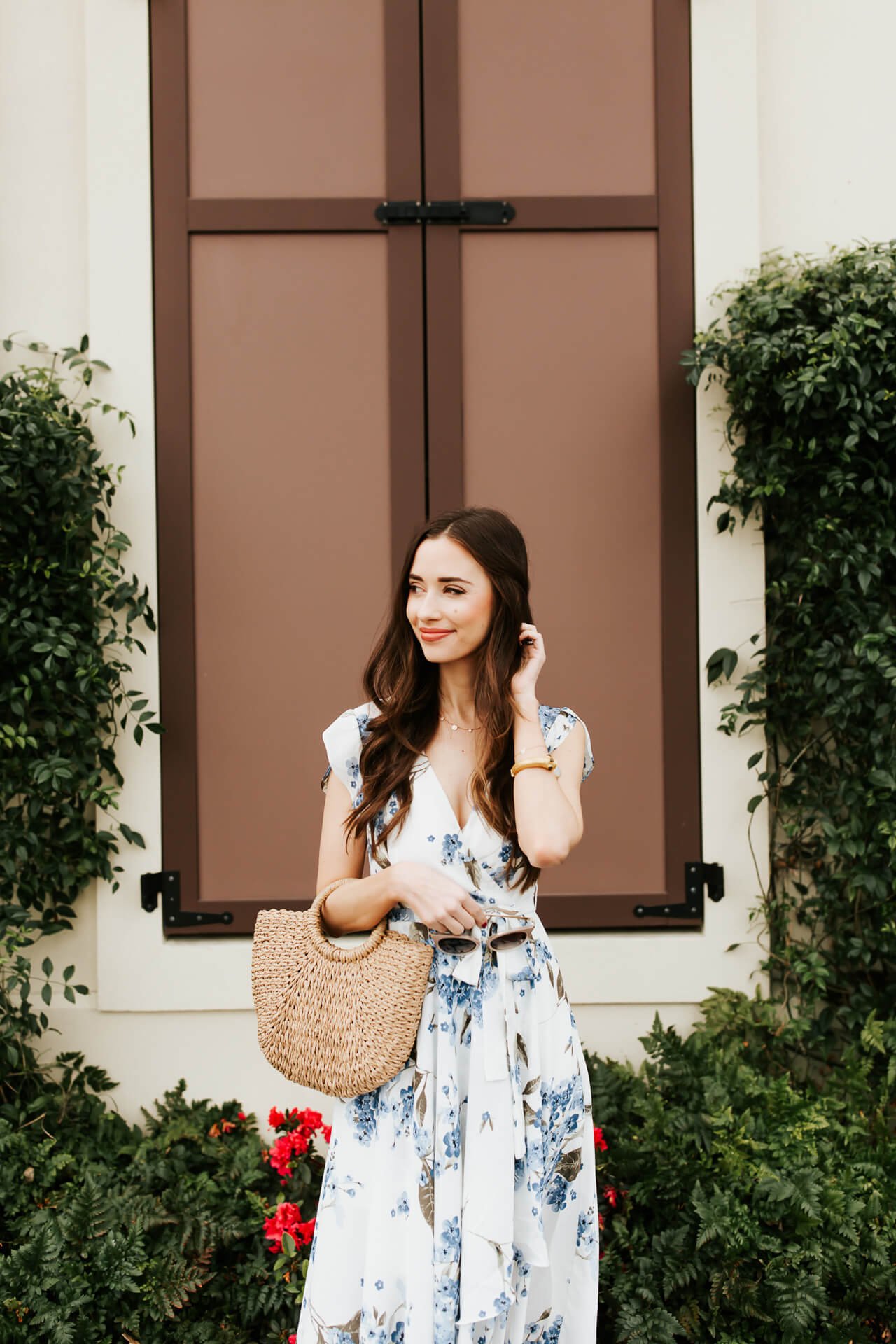 the cutest spring outfit with a floral dress and straw bag