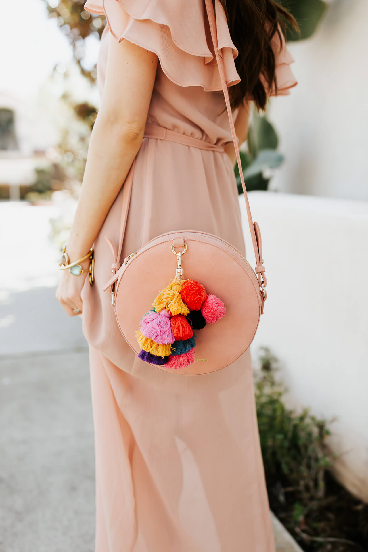 pink suede circle bag with tassels from the wolf gang