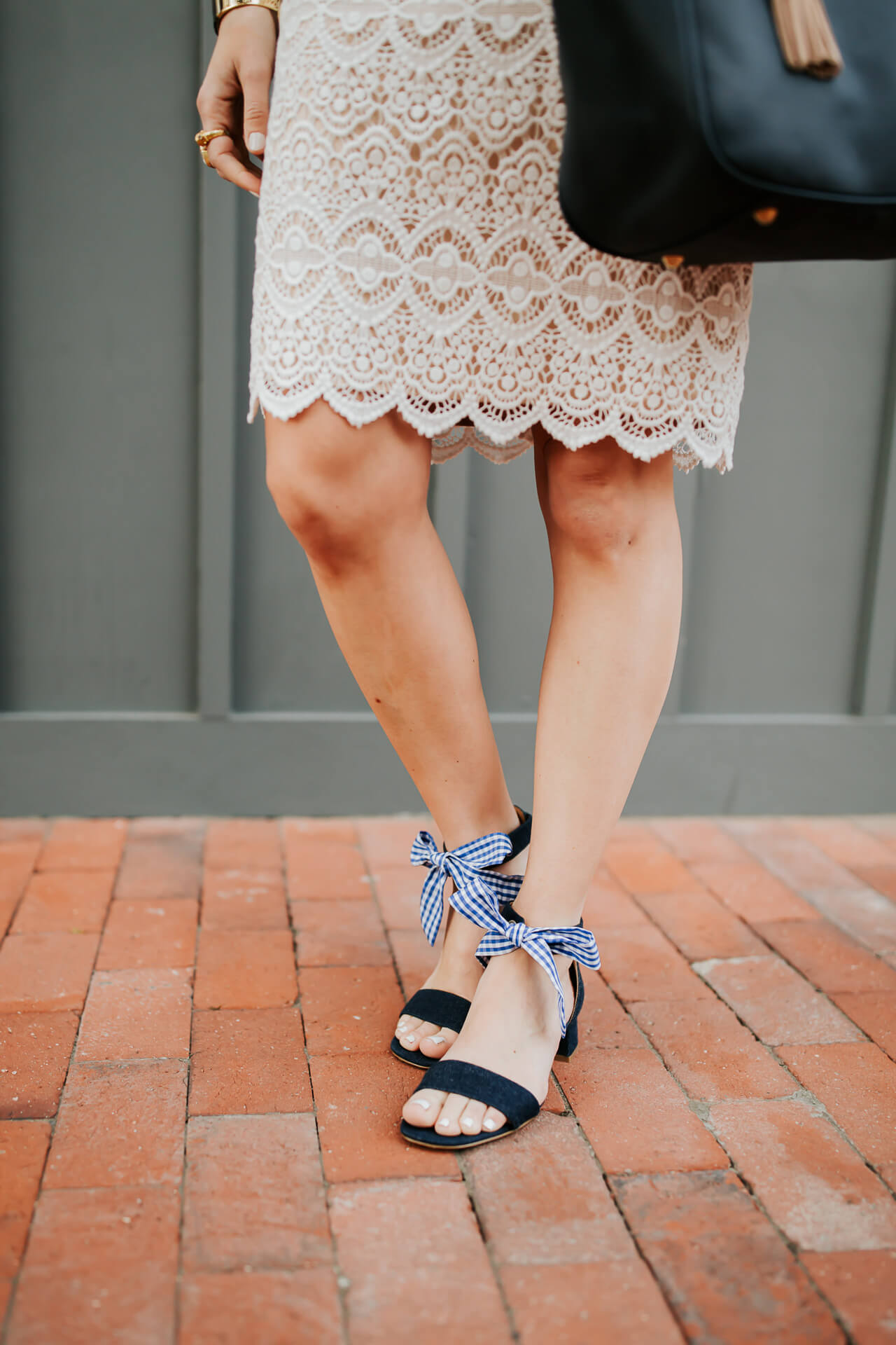 denim sandals with blue gingham bow with white lace dress