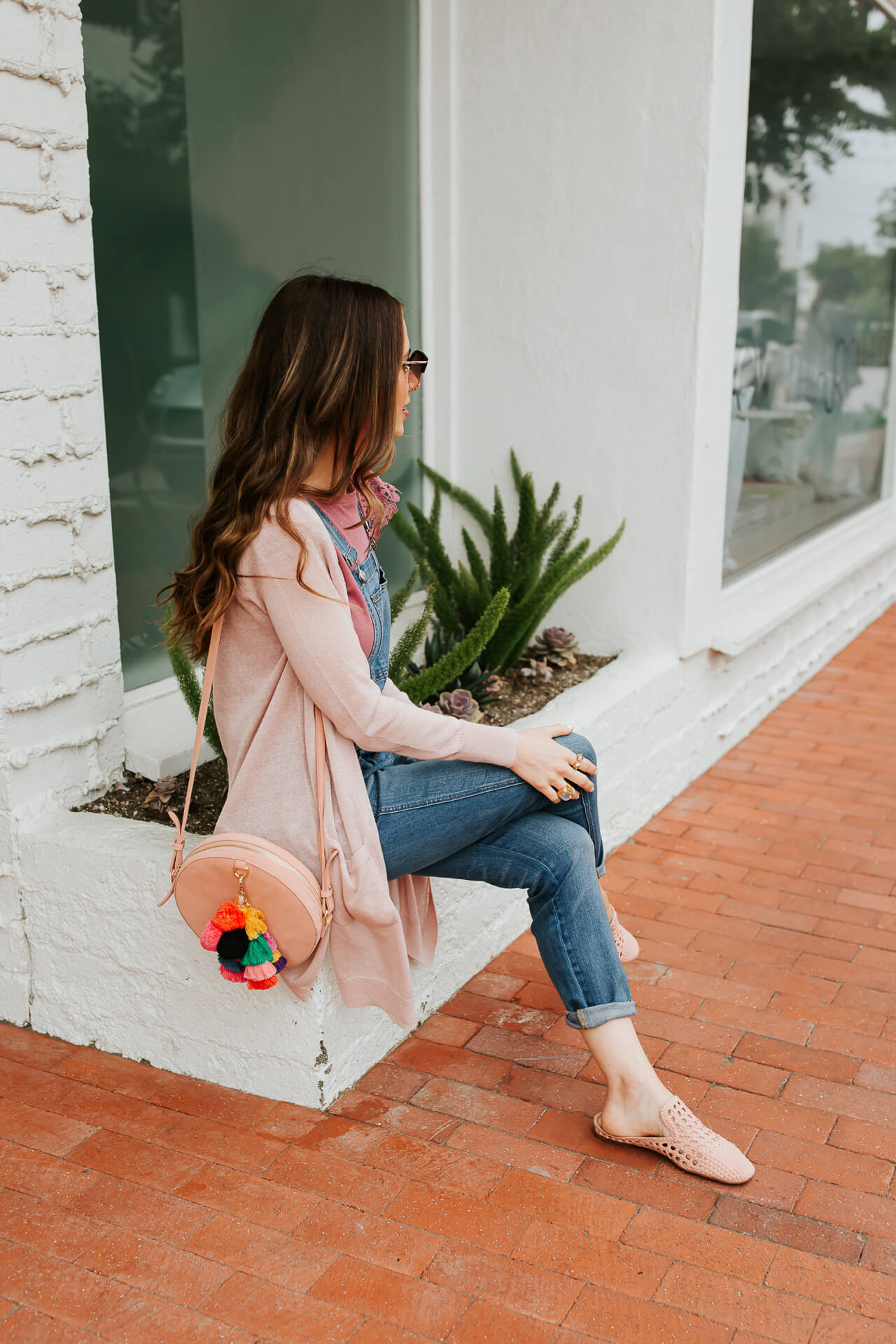 This circle bag could not be any cute with these pom poms on it! | M Loves M @marmar