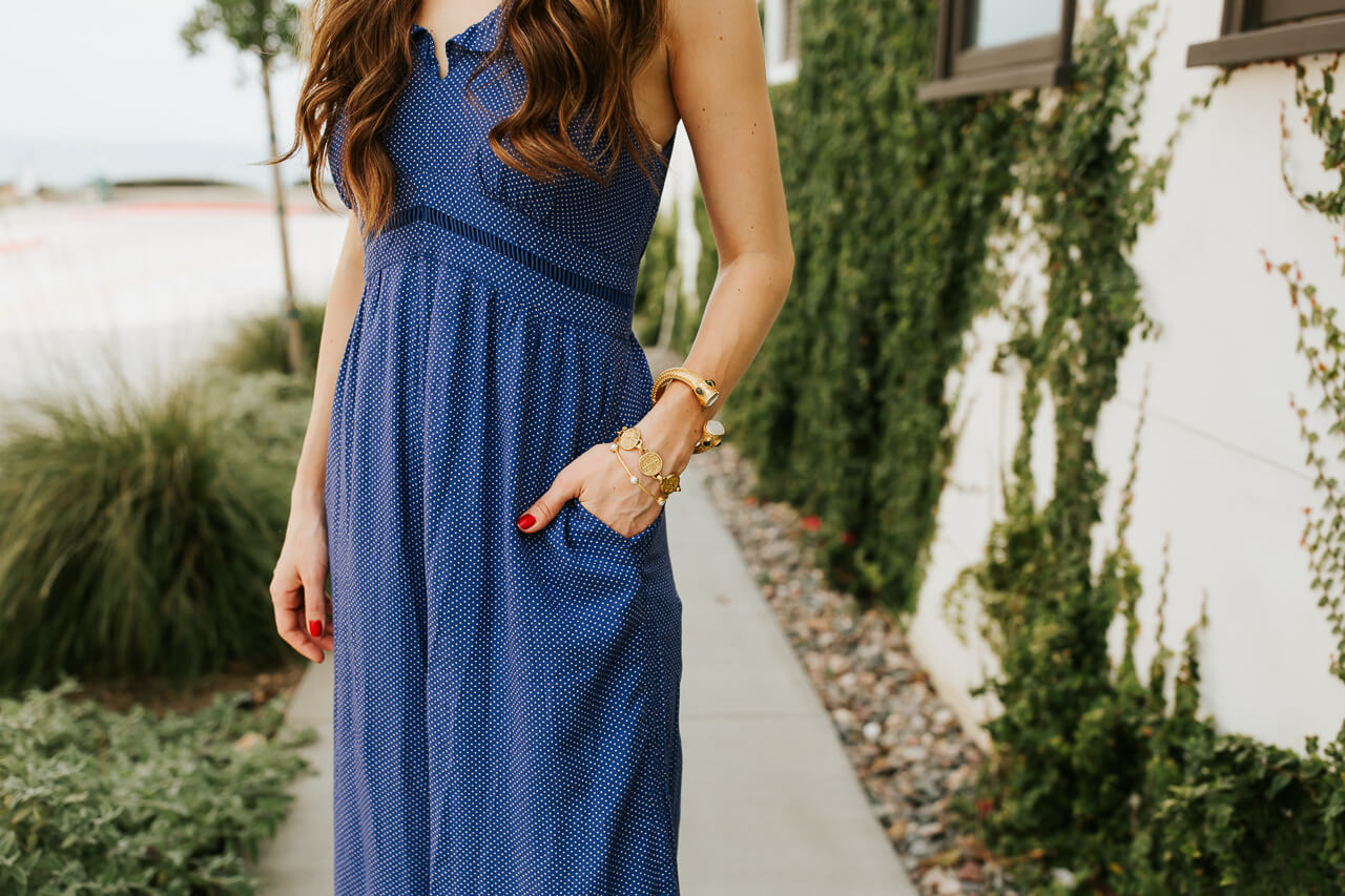 A blue jumpsuit with gold bangles and elegant accessories. | M Loves M @marmar