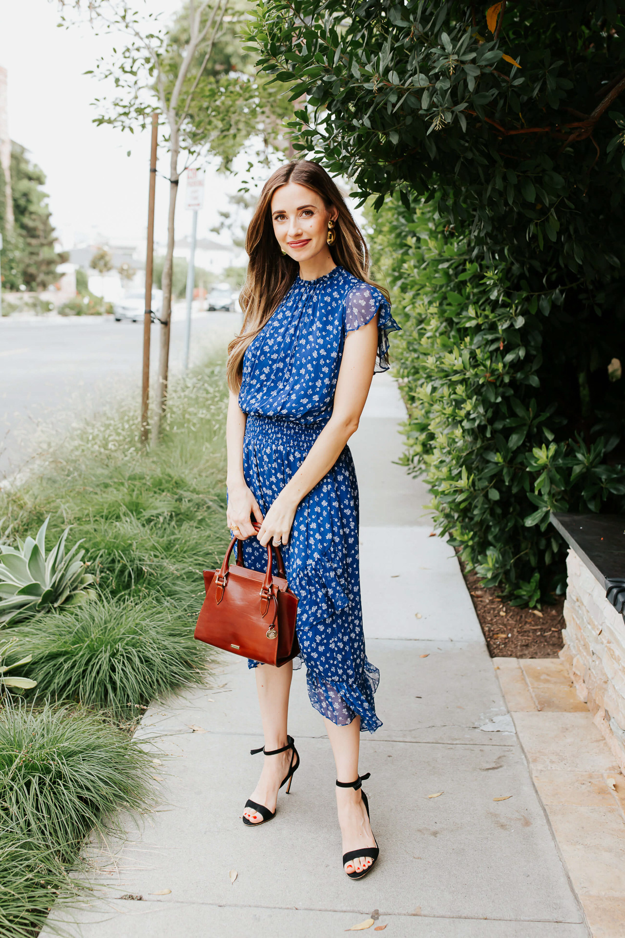 A blue floral midi dress with brown tote bag and black heels. | M Loves M @marmar