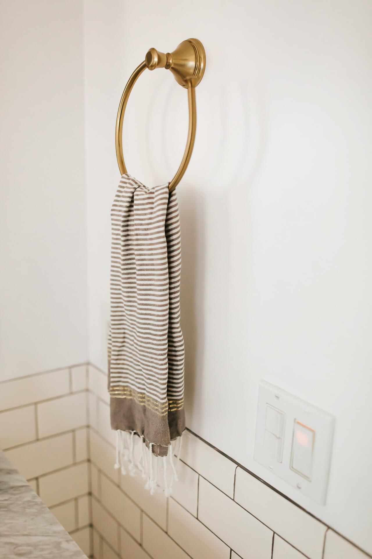 A brass towel holder is a pretty bathroom accessory. - M Loves M @marmar