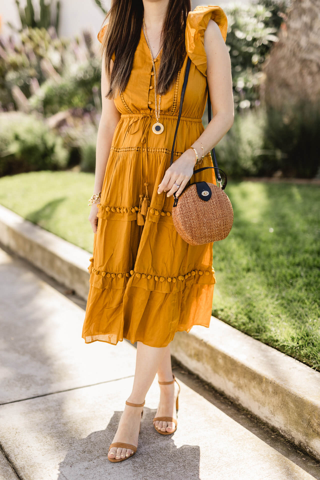 I love these spring trends! Poms and yellow! - M Loves M
