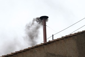 VATICAN CITY, VATICAN - MARCH 13: Black smoke billows out from a chimney on the roof of the Sistine Chapel indicating that the College of Cardinals have failed to elect a new Pope on March 13, 2013 in Vatican City, Vatican. Pope Benedict XVI's successor is being chosen by the College of Cardinals in Conclave in the Sistine Chapel. The 115 cardinal-electors, meeting in strict secrecy, will need to reach a two-thirds-plus-one vote majority to elect the 266th Pontiff. (Photo by Peter Macdiarmid/Getty Images) ORG XMIT: 163737604