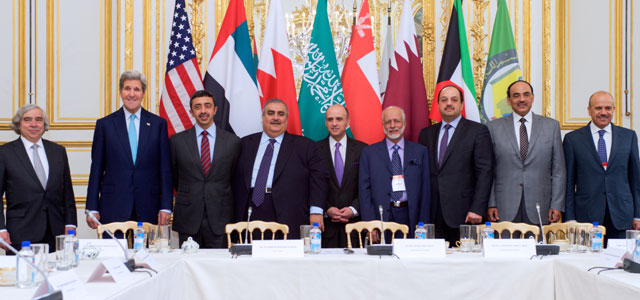 U.S. Secretary of State John Kerry and U.S Energy Secretary Dr. Ernest Moniz stand with members of the Gulf Cooperation Council gathered for a multilateral meeting at the U.S. Ambassador's Residence in Paris, France, on May 8, 2015.