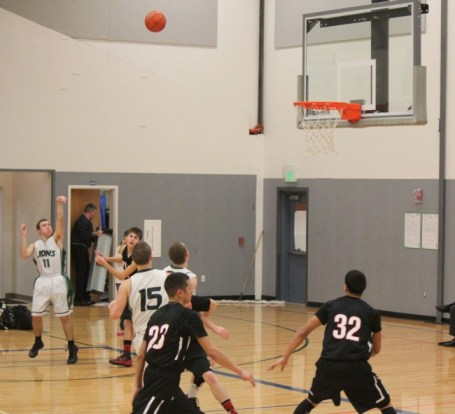 Cedar Park-Christian high scorer Wilson Reidt launching a three-point shot; (Photos courtesy of Moira Schettler)