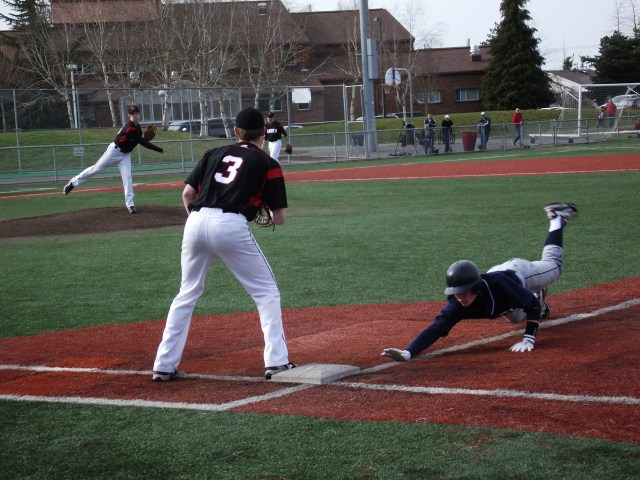 MTHS pitcher Conner Clausen attempts to pick off Glacier Peak's Ty Deckwa, with Dominic DeMiero (3) covering first base.