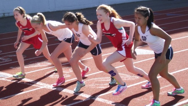 The start of the girls 3200 meters, with MTHS winner Katherine Walter on the far left and Hawk Ella Schroth sandwiched between Glacier Peak runners.