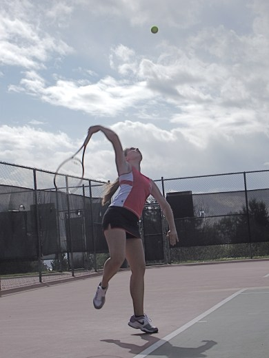 Nikki Bouche serving at Shoreview Park Monday.