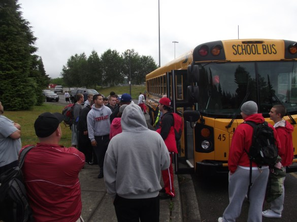 Terrace players and coaches gather at the high school early Friday morning to board buses for football camp.