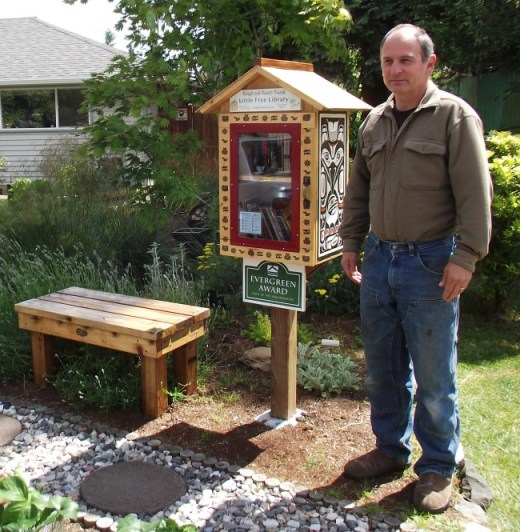 Vernon Winters with the Little Free Library in front of his home.