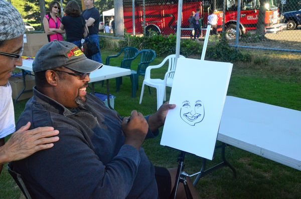 Steve Hartley was on hand to draw caricatures.  He's been doing this for 16 years, and he's fast, completing his drawings in less than two minutes. (Larry Vogel photo)