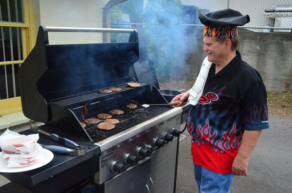 MLT Senior Center Director and former Edmonds Mayor Mike Cooper was on hand to flip burgers for the crowd.