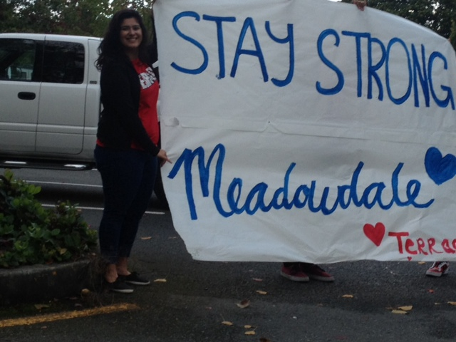 Maria Fuller took these photos Monday morning of Mountlake Terrace High School students who were on hand Monday to greet Meadowdale High students grieving over the loss of 16-year-old classmate Matthew Truax. The MHS junior collapsed and died during PE class last Friday.