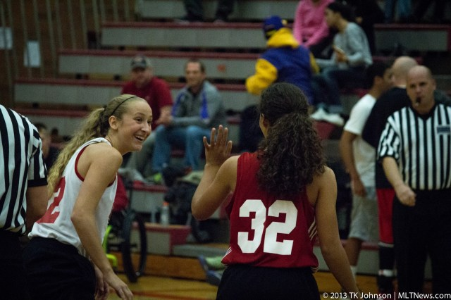 MTHS juniors Samantha Romanowski and Riley Zucker (32) scrimmage Tuesday. Refereeing is Todd Weber, who coaches the MTHS Cross Country boys and girls teams.