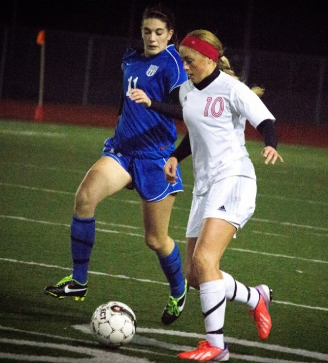 Maddy Kristjanson takes the ball down the field Thursday.