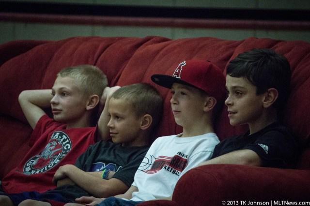 """Kids enjoy the """"Couch Potato Corner"""" -- located on the corner of the court. Those who ended up on the couch won contests that were held throughout the night or were selected from the audience."""
