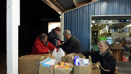 Food bank volunteers sort through the donations collected by the troop.