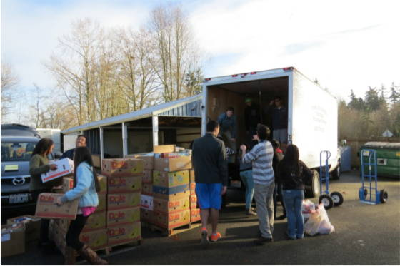 Students unload the 250 boxes on to nine pallets and weighed -- a whopping 11,800 pounds.