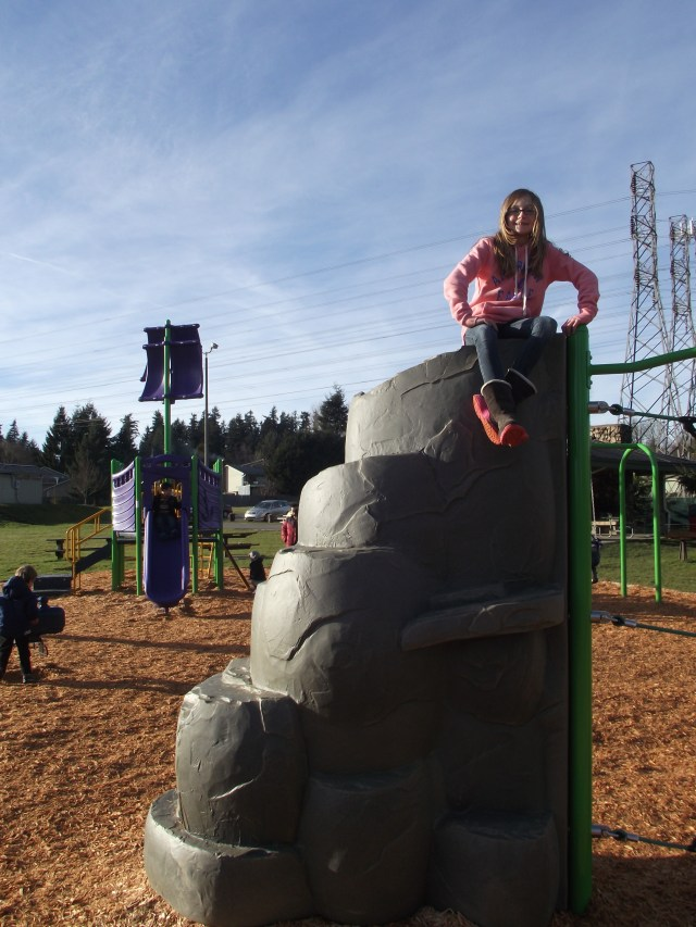 A sunny Sunday afternoon proved to be a good time for local families to check out the recently opened new playground equipment at Brier Park. In the pink sweatshirt is s 10-year-old Abby Lundy of Brier.