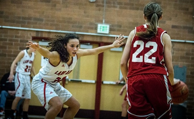Terrace's Riley Zucker applies defensive pressure to Stanwood's Samantha Powell. (Photo by Doug Petrowski)
