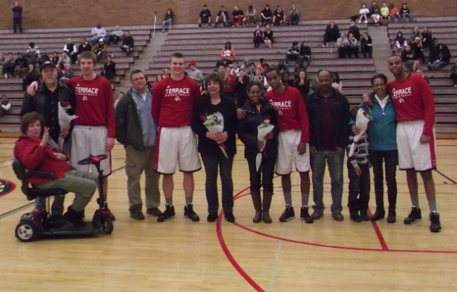 Hawks seniors and their families pose for a group shot.