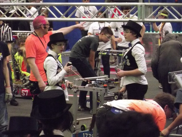 Chill Out! team members Kai Hiar (on left) and Riley Gerow prepare to move the robot out of the arena following a match.