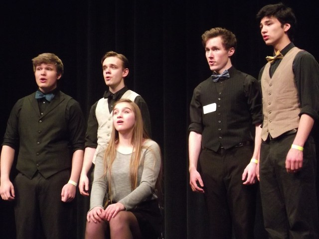 """AJ Russo, Ian Slater, Gabi Gilbride, Luke Robinson, Choji Yamamoto from Bellingham High School perform """"Light a Rose"""" from The Music Man. Solo, duet and ensemble performers who scored in the upper 20 percentile at the festival earned a spot at the state competition to be held Mar. 20-22 at Central Washington University in Ellensburg."""