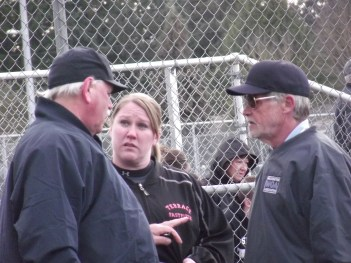MTHS softball coach Shannon Rasmussen questions the umpires in the decisive ninth inning of the Hawks' game against Marysville-Pilchuck.