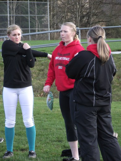 Seniors Maddy Kristjanson (left) and Hannah Baisch (center) will be key members of the Terrace softball team this season for Coach Shannon Rasmassen, at right.