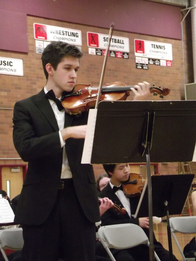 Student Michael Verlan was a featured soloist with the Mountlake Terrace High School Chamber Orchestra at Wednesday's Edmonds School District SE Quad Orchestra Concert held at Mountlake Terrace High School. District students from grades 5-12 performed at the joint concert. Choral groups take the stage on Thursday in another SE Quad Concert, also at MTHS. (Photos by Doug Petrowski)
