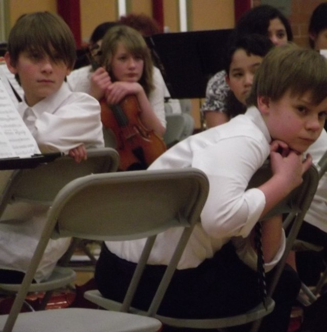 Younger Edmonds School District students wait for their turn to perform at the SE Quad Orchestra Concert.