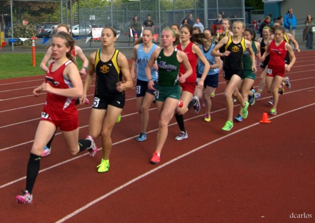 MTHS runner Katherine Gustafson leads the girls 1600 meters. (Photos by David Carlos) .
