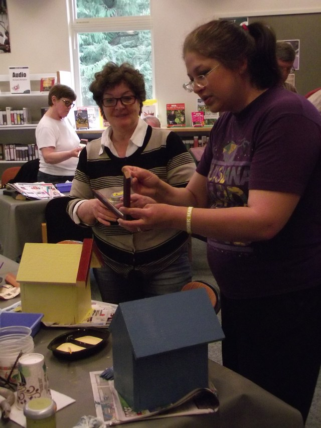 Natalia Nikolskaya of Shoreline (left) helps daughter-in-law Beth Pearce of Mountlake Terrace pick out some accessories to add to her birdhouse creation.